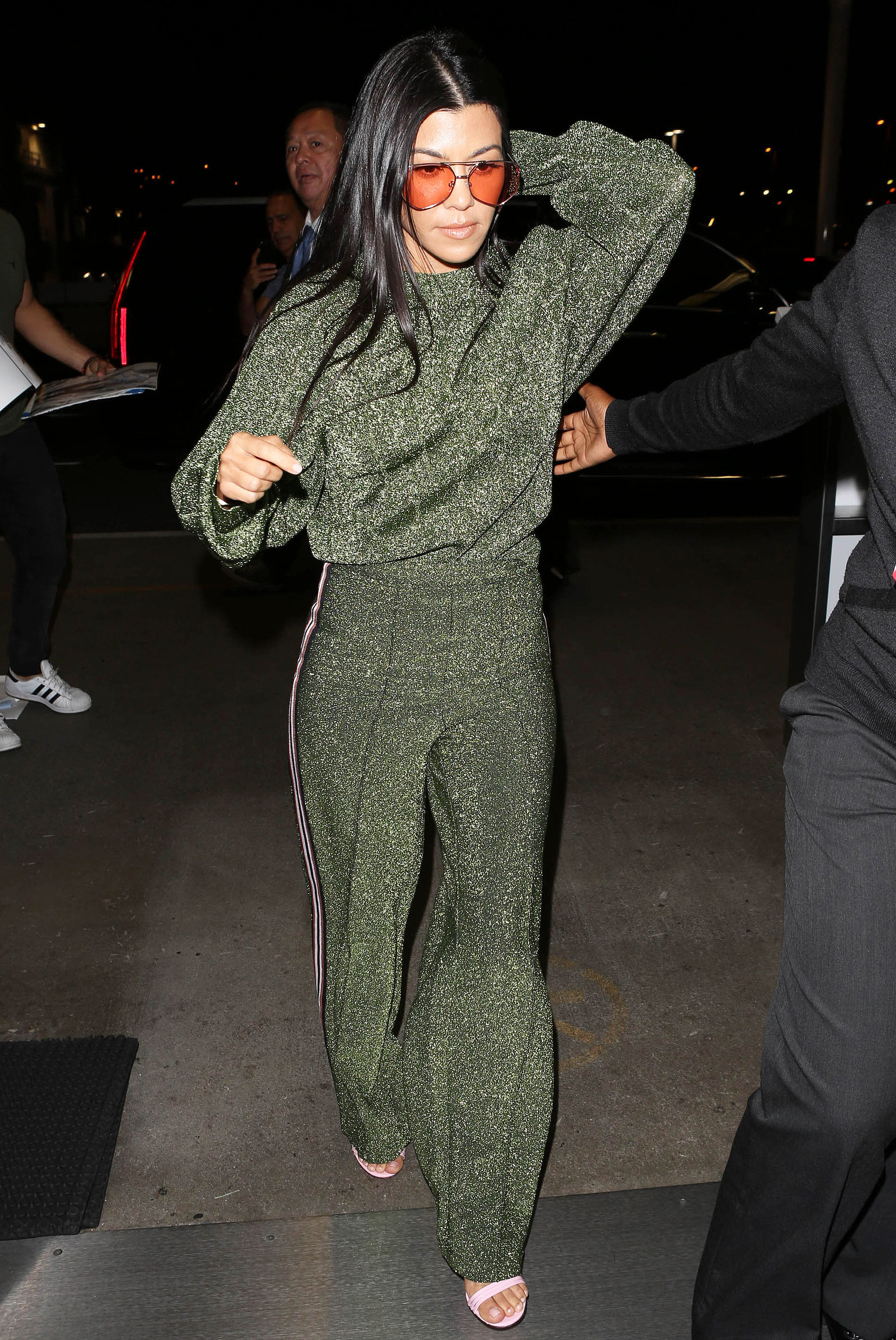 Kourtney and Khloe Kardashian Traveled in Glitter Sweats and Stilettos, As Only the Klan Can