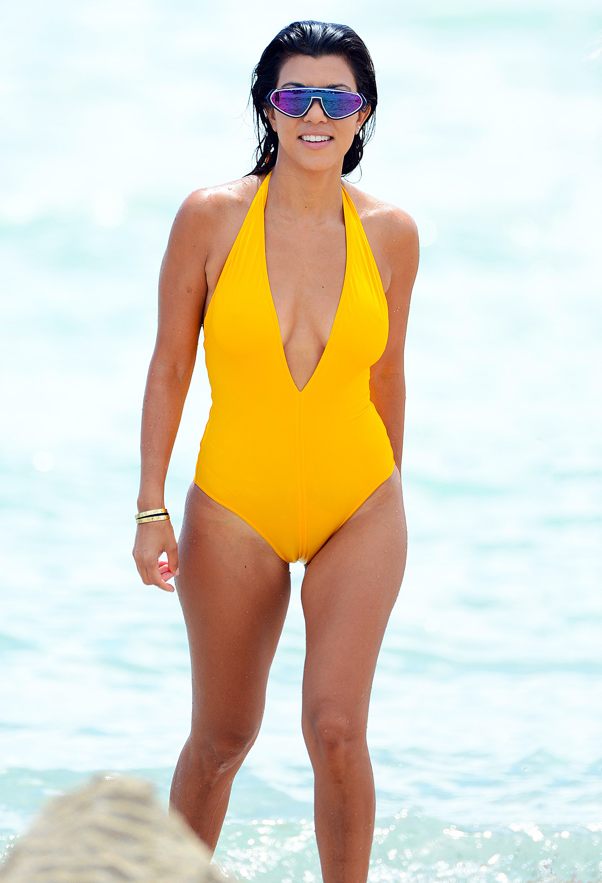 kourtney kardashian stuns in plunging yellow onepiece