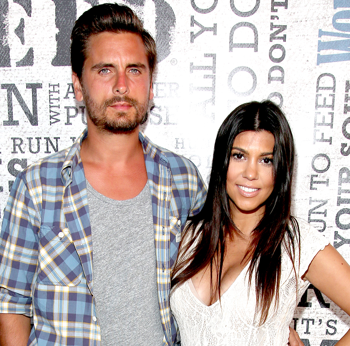 "Kourtney Kardashian and Scott Disick attend Women's Health Hosts Hamptons ""Party Under The Stars"" for RUN10 FEED10 at Bridgehampton Tennis and Surf Club on August 9, 2014 in Bridgehampton, New York."