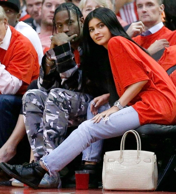 Travis Scott and Kylie Jenner watch courtside during Game Five of the Western Conference Quarterfinals game of the 2017 NBA Playoffs at Toyota Center on April 25, 2017 in Houston, Texas.