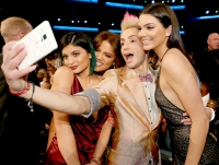 Kylie Jenner, Khloe Kardashian, Frankie J. Grande, and Kendall Jenner take a selfie at the 2014 American Music Awards at Nokia Theatre L.A. Live on November 23, 2014 in Los Angeles, California.