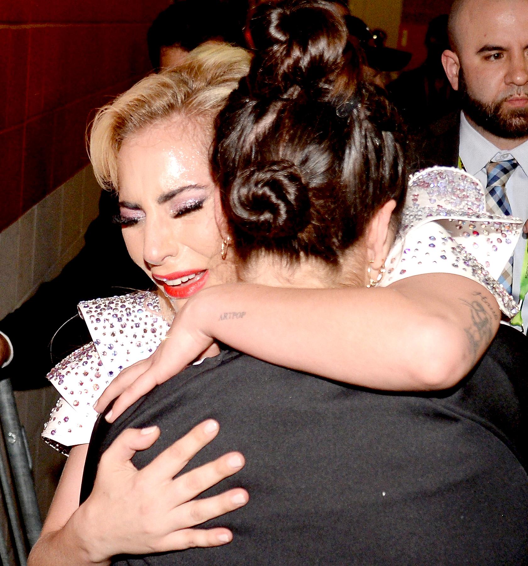 Lady Gaga hugs her sister Natali Germanotta backstage after the Pepsi Zero Sugar Super Bowl LI Halftime Show at NRG Stadium on February 5, 2017 in Houston, Texas.