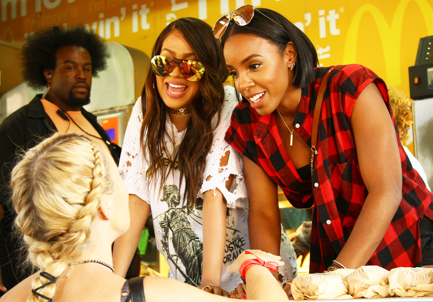La La Anthony and Kelly Rowland serving McDonald's in Philadelphia.