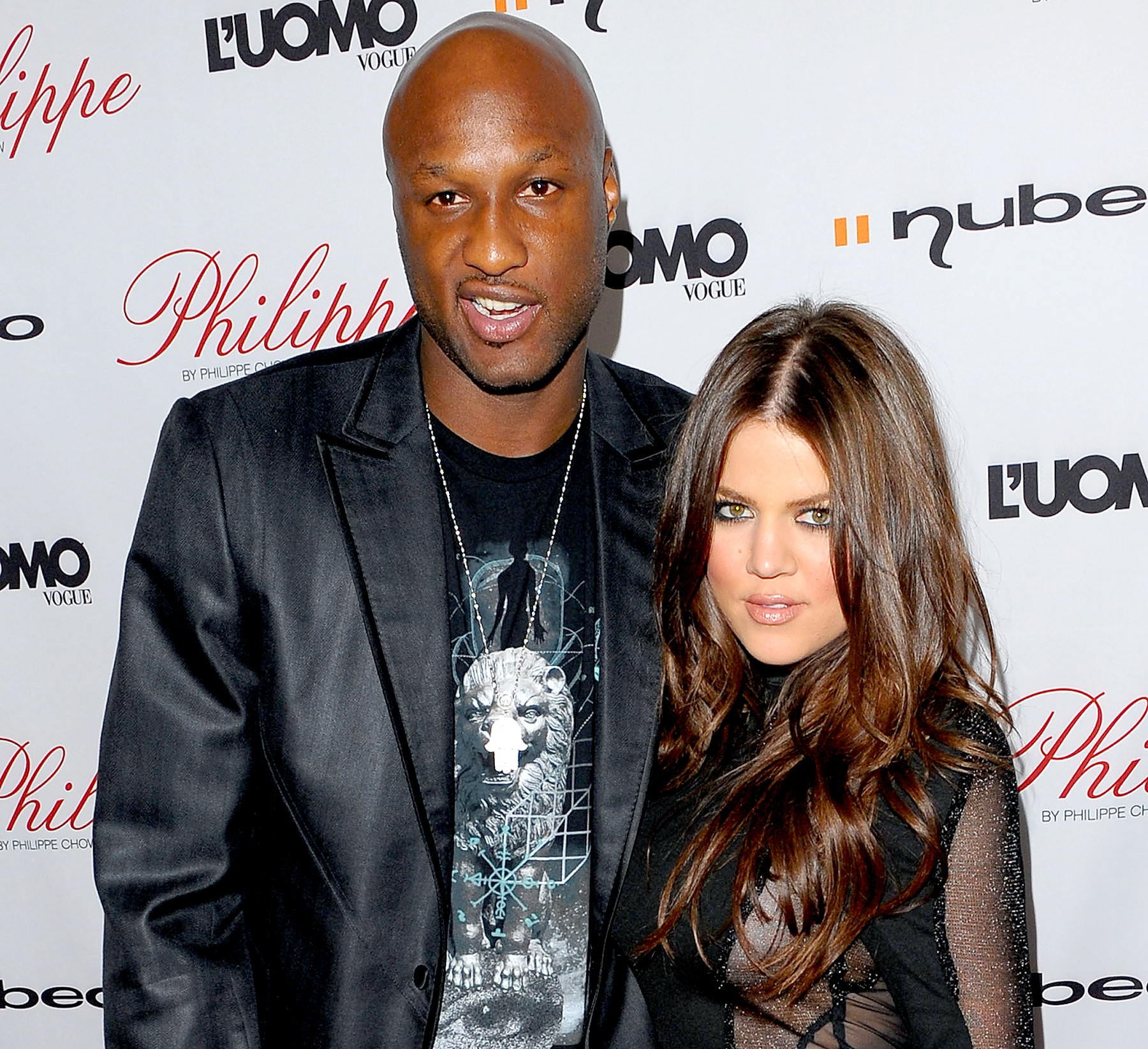 Khloé Kardashian and Lamar Odom arrive at the Philippe restaurant grand opening in West Hollywood on October 12, 2009.