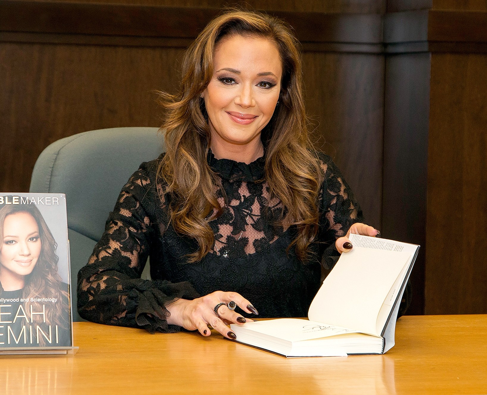 """Leah Remini signs copies of her new book """"Troublemaker: Surviving Hollywood and Scientology"""" at Barnes & Noble at The Grove on December 8, 2015 in Los Angeles, California."""