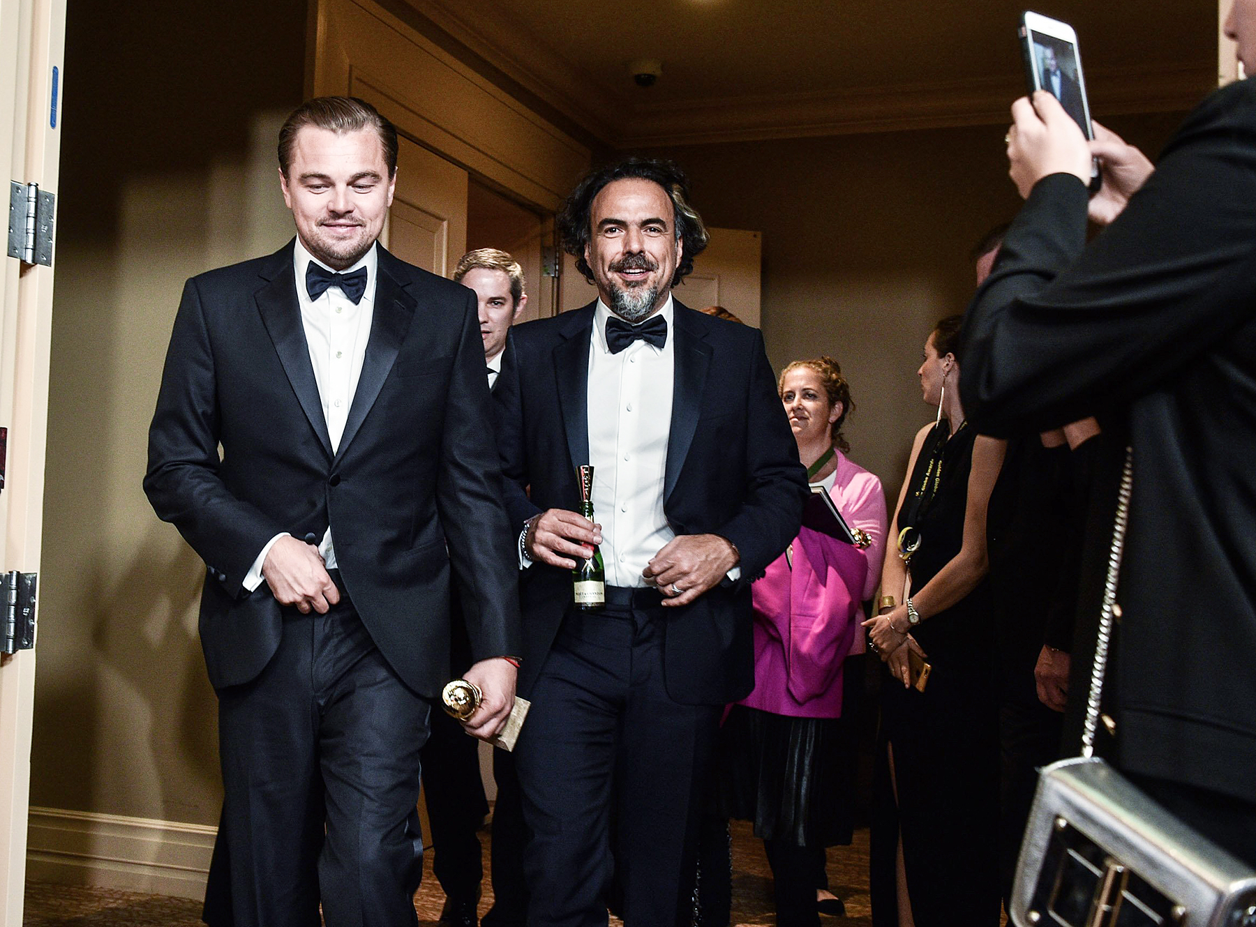 Leonardo DiCaprio and director Alejandro Gonzalez Inarritu in the press room at the Golden Globes 2016