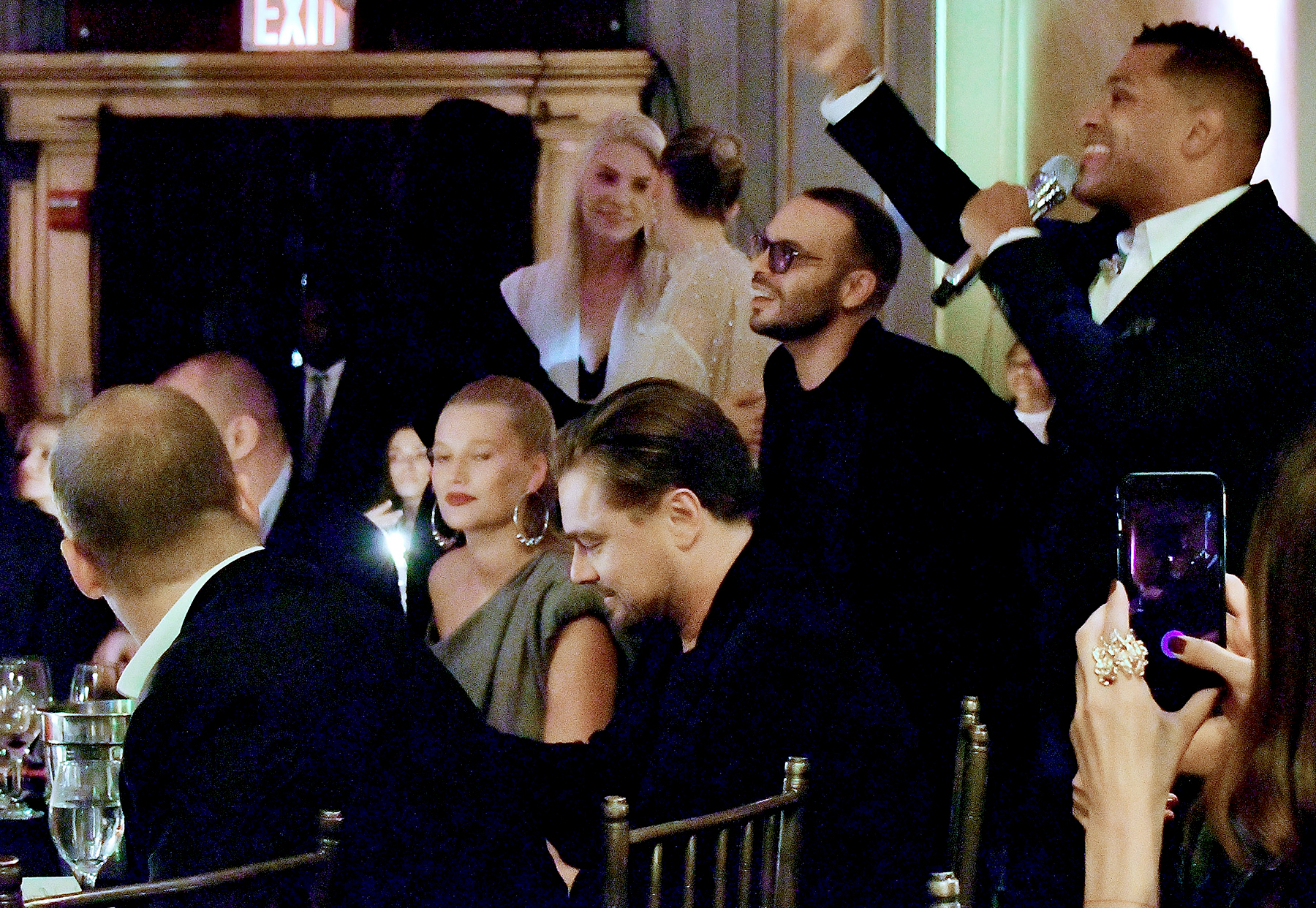 Maxwell (R) performs in front of Leonardo DiCaprio and Toni Garnn at the Unitas Third Annual Gala Against Human Trafficking at Capitale in New York City on September 12, 2017.