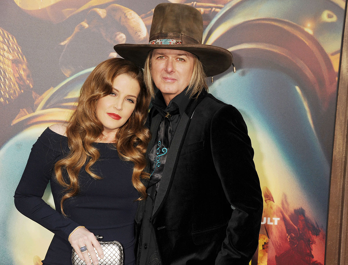 Singer Lisa Marie Presley (L) and musician Michael Lockwood arrive at the 'Mad Max: Fury Road' Los Angeles Premiere at TCL Chinese Theatre IMAX on May 7, 2015 in Hollywood, California