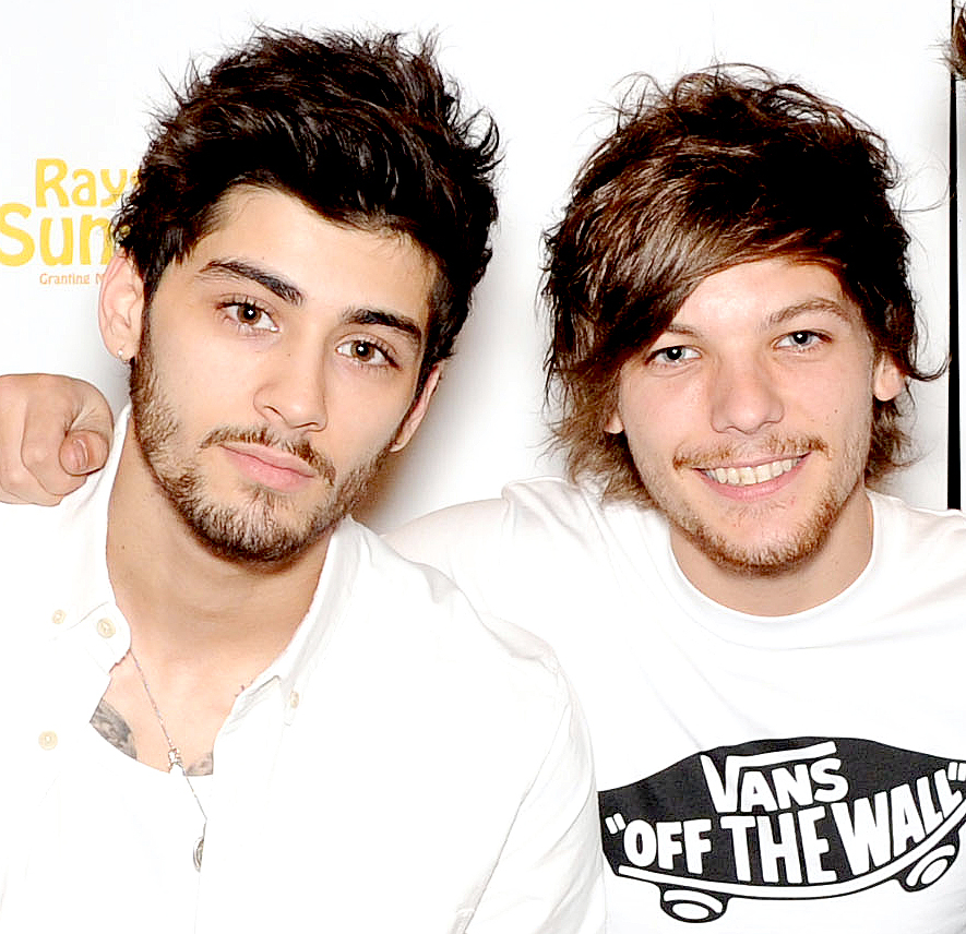 Zayn Malik and Louis Tomlinson pose for photographs at Wembley Arena as they made the wishes of 60 seriously ill children come true and met the children prior to performing at Wembley Stadium on June 8, 2014 in London, United Kingdom.