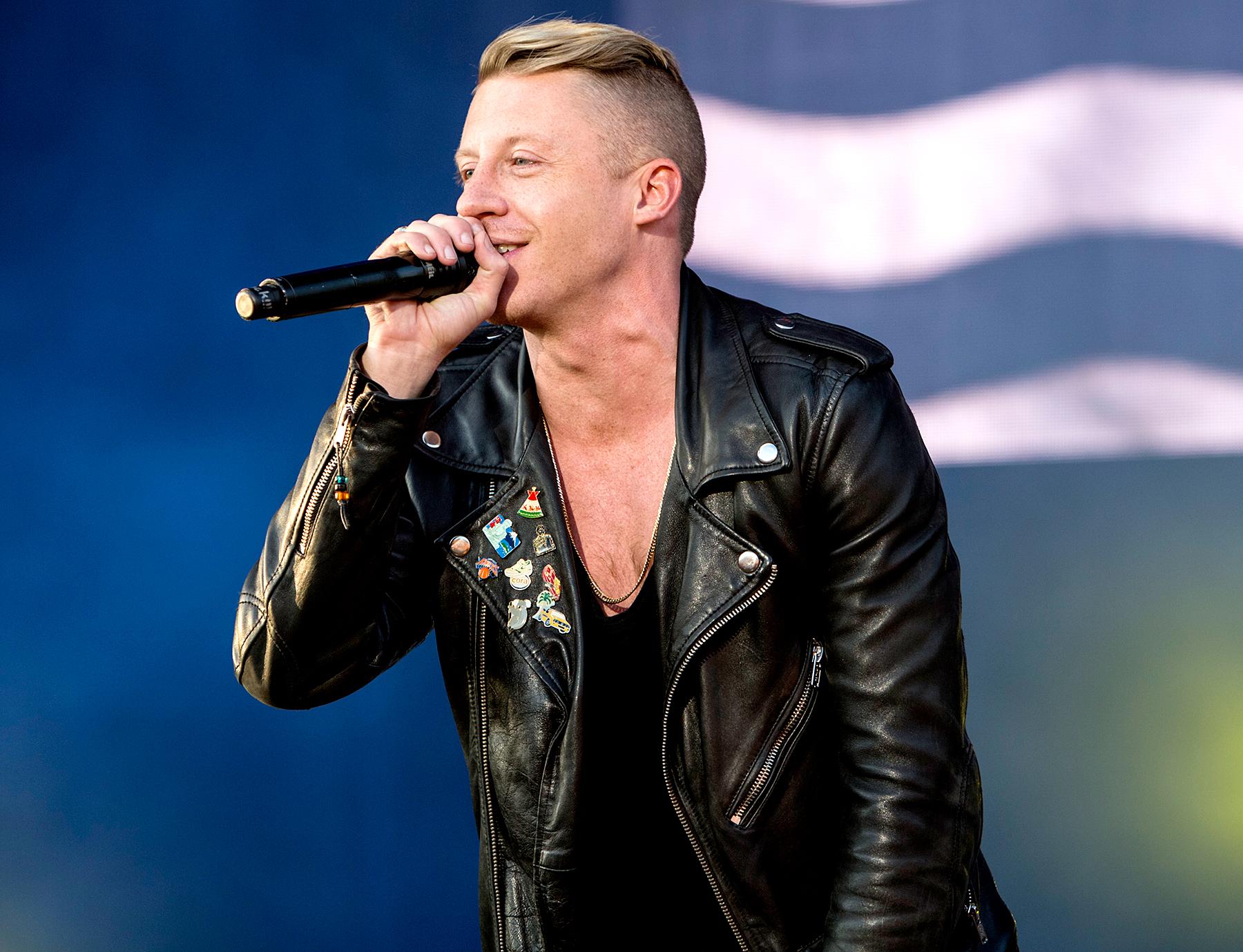 Macklemore of Macklemore & Ryan Lewis performs on stage at Leeds Festival at Bramham Park on August 22, 2014 in Leeds, United Kingdom.