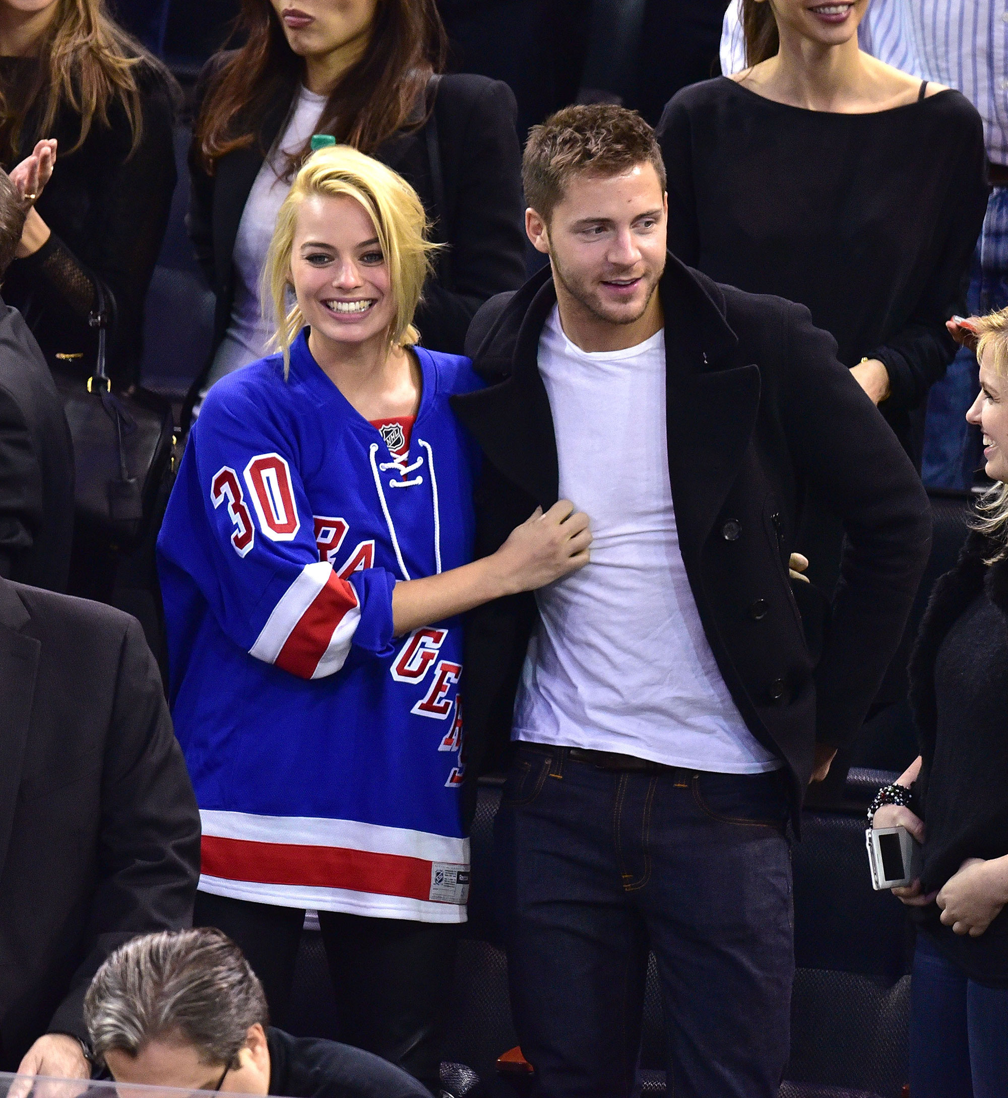 Margot Robbie and Tom Ackerley attend a New York Rangers Game in 2015