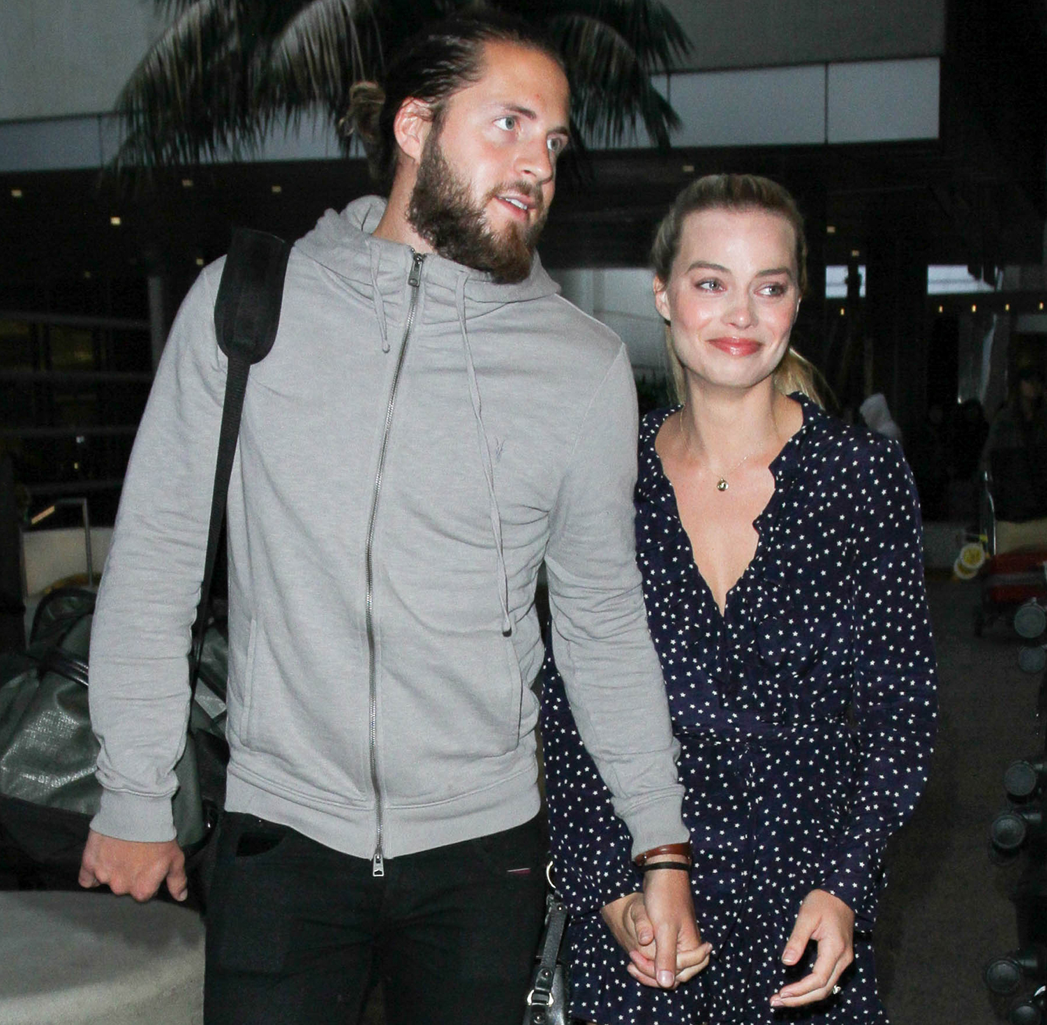 Margot Robbie and Tom Ackerley are seen at LAX on January 02, 2017 in Los Angeles, California.