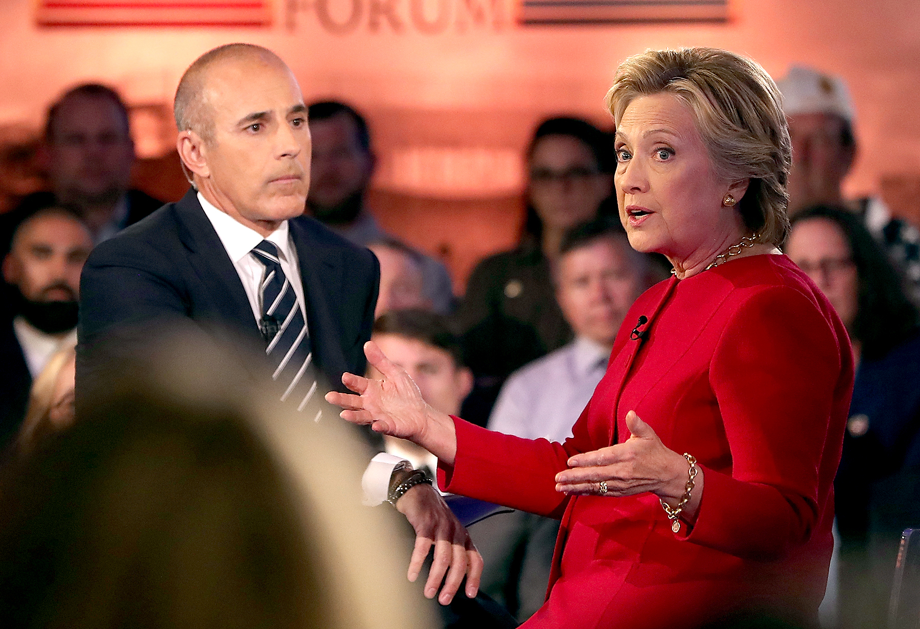 Matt Lauer looks on as Democratic presidential nominee and former Secretary of State Hillary Clinton speaks during the NBC News Commander-in-Chief Forum on Sept. 7, 2016, in New York City.