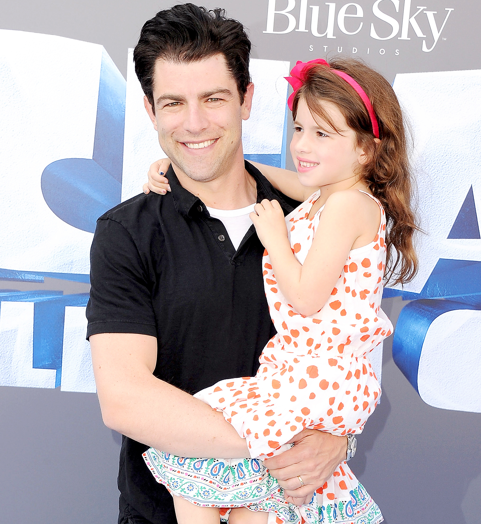 "Max Greenfield and daughter Lilly Greenfield arrive at the screening Of ""Ice Age: Collision Course"" at Zanuck Theater at 20th Century Fox Lot on July 16, 2016 in Los Angeles, California."