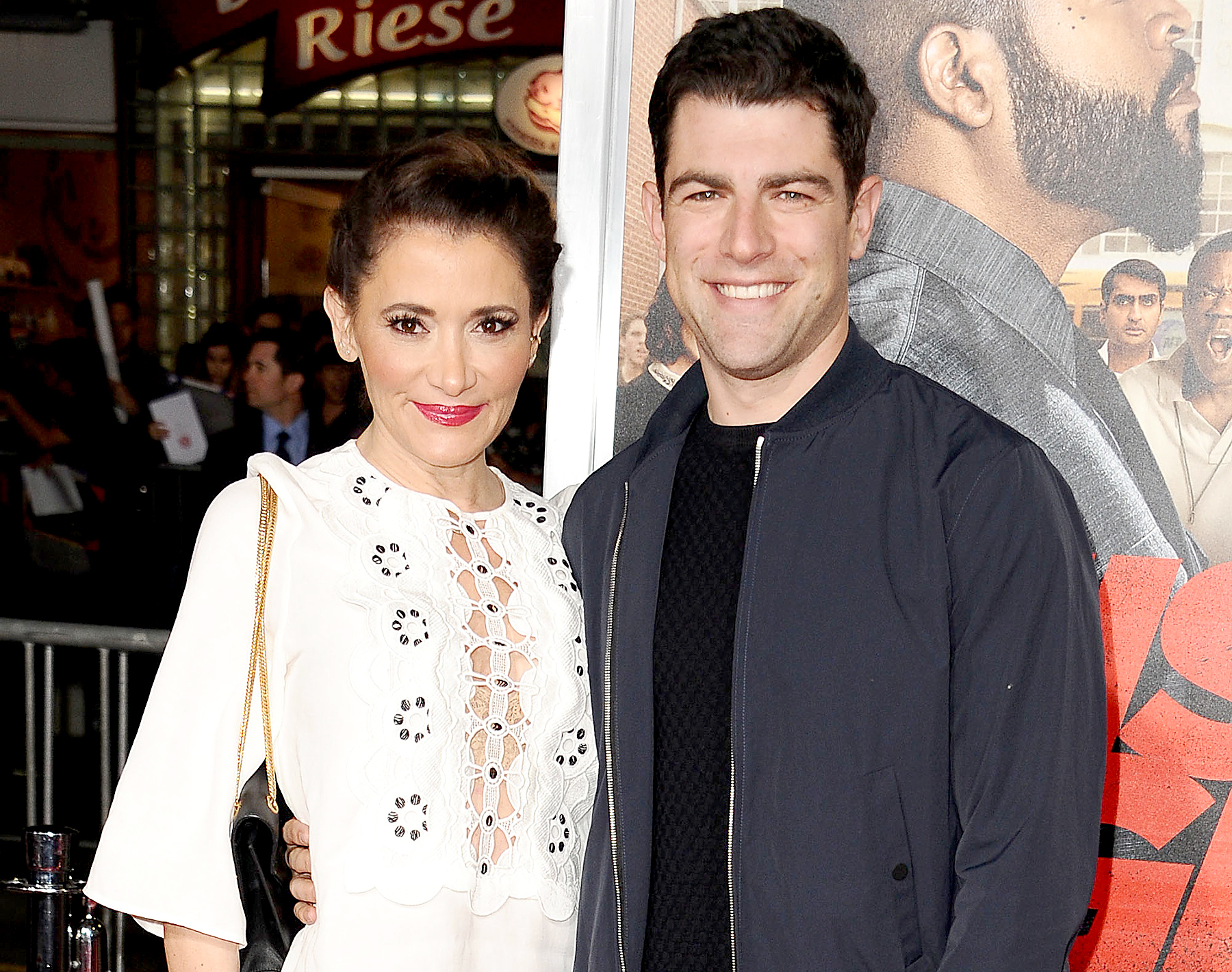 "Max Greenfield and Tess Sanchez attend the premiere of ""Fist Fight"" at Regency Village Theatre on February 13, 2017 in Westwood, California."