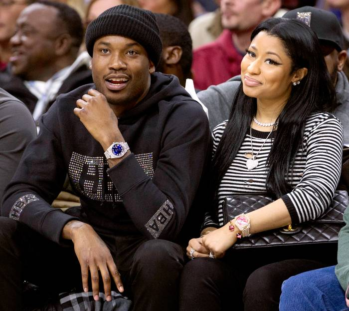 Meek Mill and Nicki Minaj watch the game between the Golden State Warriors and Philadelphia 76ers on January 30, 2016 at the Wells Fargo Center in Philadelphia, Pennsylvania.