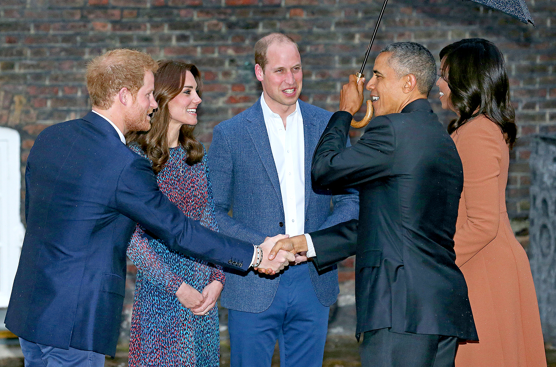 US President Barack Obama shakes hands with Britain's Prince Harry as Prince William, Duke of Cambridge and Catherine Duchess of Cambridge greet the US president and US First Lady Michelle Obama in London, April 22, 2016.