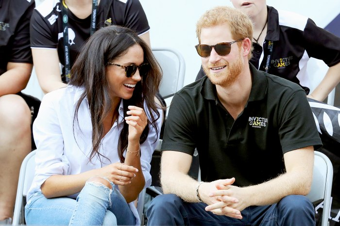 Prince Harry and Meghan Markle attend a Wheelchair Tennis match during the Invictus Games 2017 at Nathan Philips Square in Toronto on September 25, 2017.