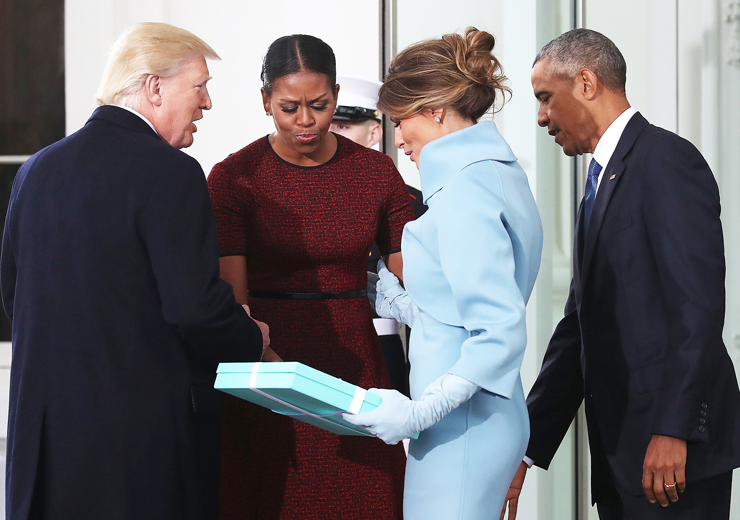 Donald Trump,and Melania Trump, are greeted by President Barack Obama and his wife first lady Michelle Obama, upon arriving at the White House on January 20, 2017 in Washington, DC.