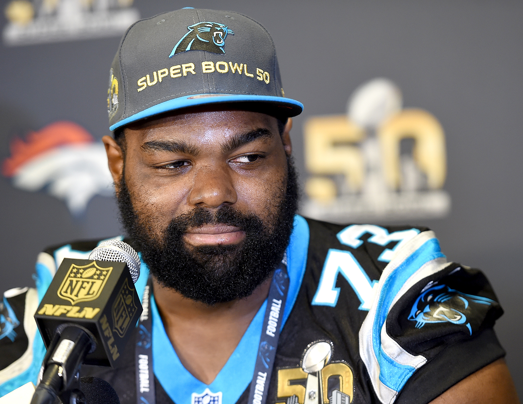 Michael Oher #73 of the Carolina Panther addresses the media prior to Super Bowl 50 at the San Jose Convention Center/ San Jose Marriott on February 2, 2016 in San Jose, California.