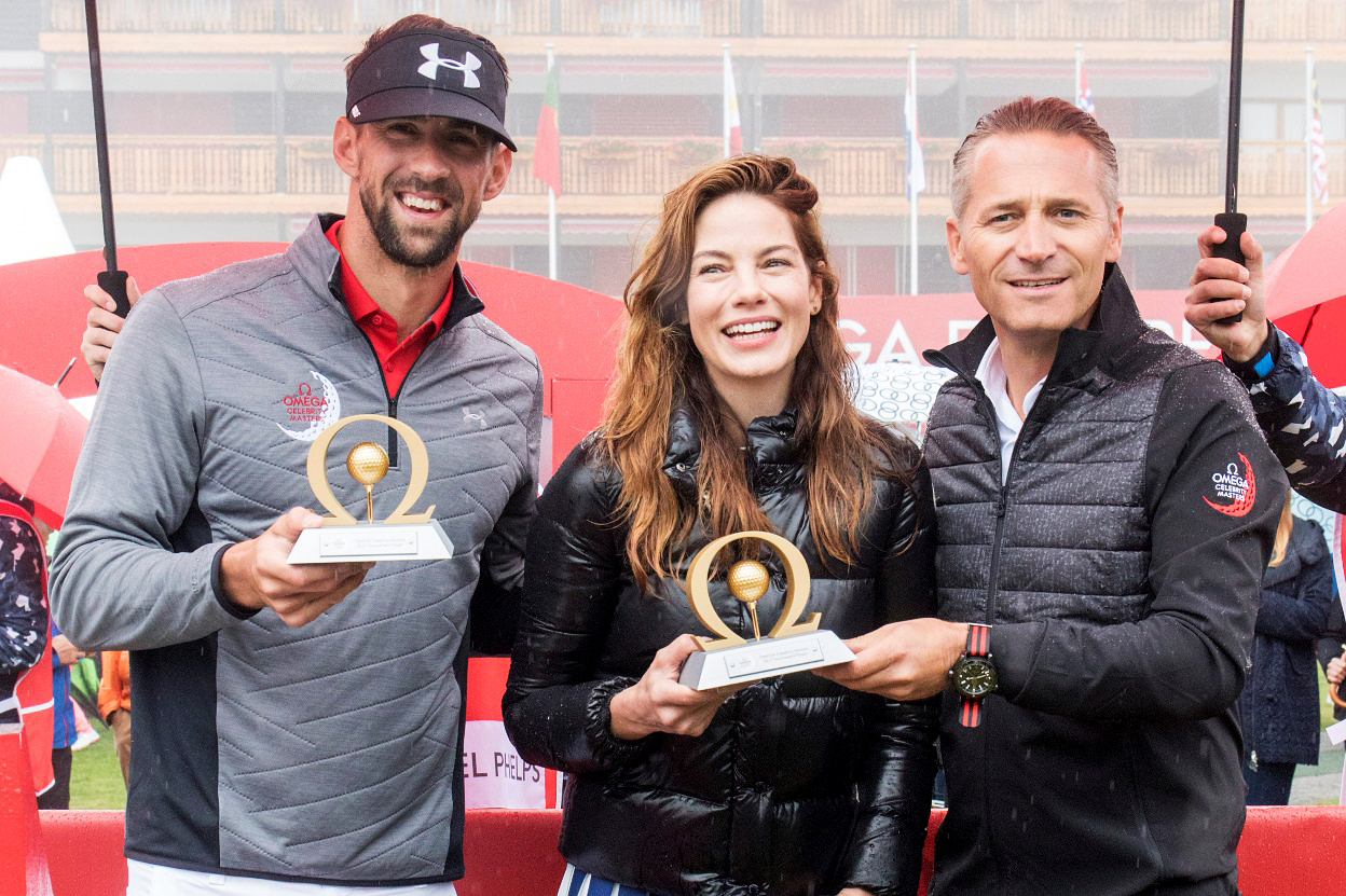 Michelle Monaghan and Michael Phelps shared the winner's trophy at OMEGA's inaugural Celebrity Masters in Switzerland.