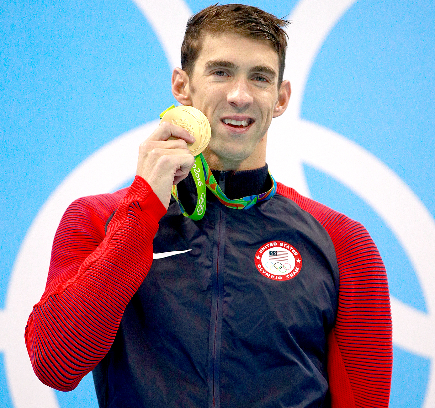 Gold medalist Michael Phelps of the United States poses on the podium during the medal ceremony for the Men's 200m Butterfly Final on Day 4 of the Rio 2016 Olympic Games at the Olympic Aquatics Stadium on August 9, 2016 in Rio de Janeiro, Brazil.