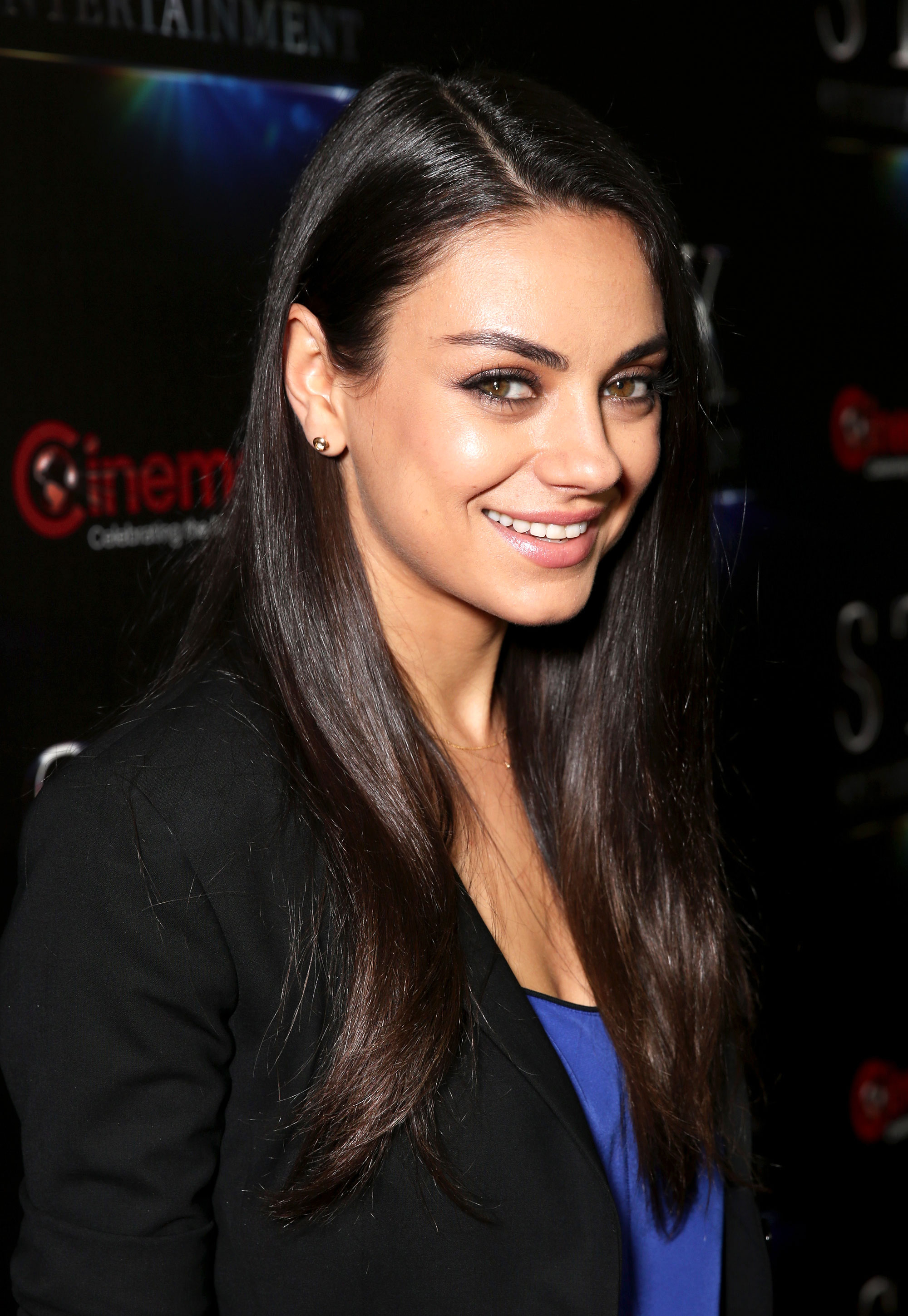 Mila kunis debuts a short hairstyle on red carpet photos mila kunis in april with her long hair styled straight todd williamsongetty urmus Image collections