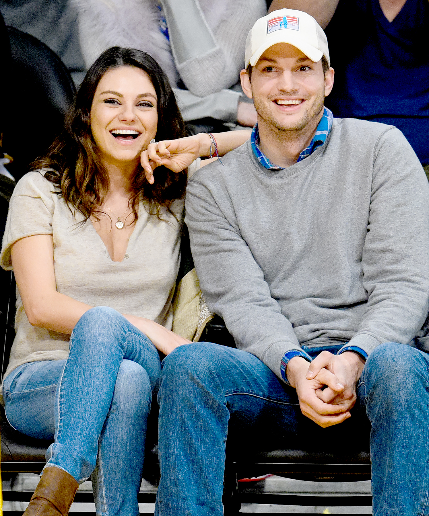 Mila Kunis and Ashton Kutcher attend a basketball game between the Oklahoma City Thunder and the Los Angeles Lakers at Staples Center on December 19, 2014 in Los Angeles, California.