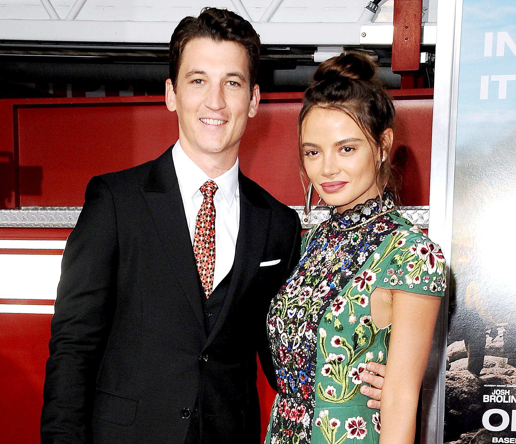 """Miles Teller and Keleigh Sperry attend the premiere of """"Only the Brave"""" at Regency Village Theatre on October 8, 2017 in Westwood, California."""
