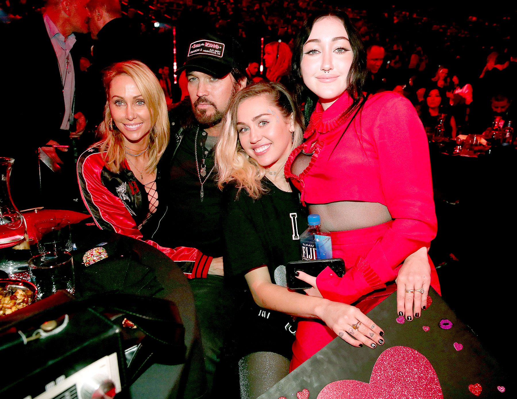 Tish Cyrus, Billy Ray Cyrus, Miley Cyrus, and Noah Cyrus pose with a sign reading 'I heart Noah Cyrus' during the 2017 iHeartRadio Music Awards which broadcast live on Turner's TBS, TNT, and truTV at The Forum on March 5, 2017 in Inglewood, California.