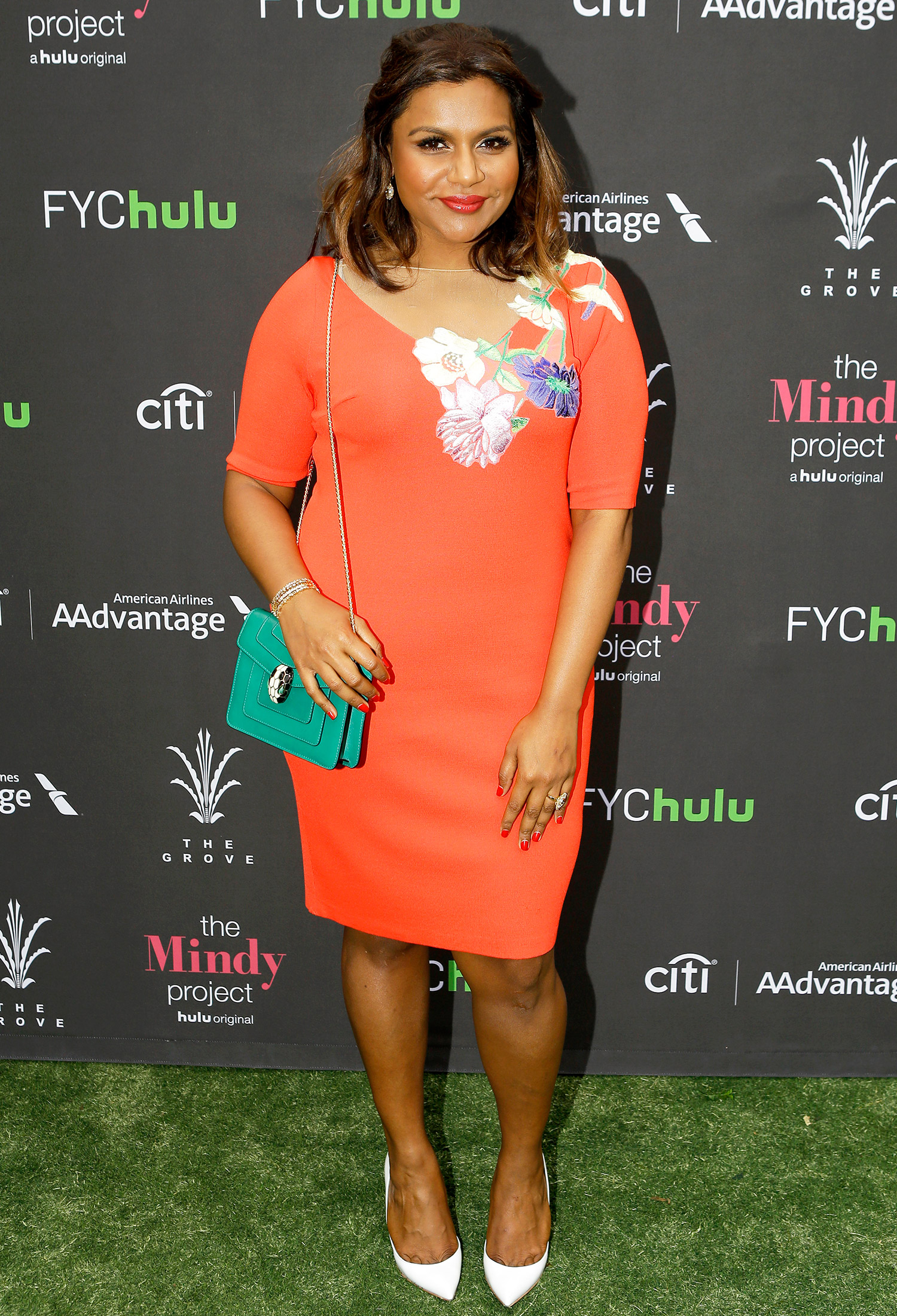 Mindy Kaling Perfectly Pulls Off An Orange Dress At A Style Event