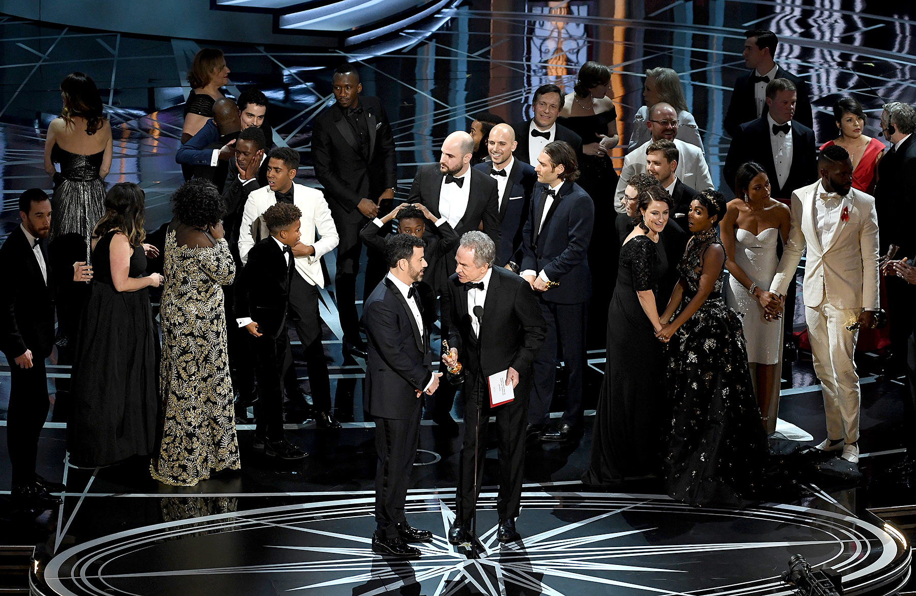 Actor Warren Beatty (R) explains a presentation error which resulted in Best Picture being announced as 'La La Land' instead of 'Moonlight' with host Jimmy Kimmel onstage during the 89th Annual Academy Awards at Hollywood & Highland Center on February 26, 2017 in Hollywood, California.