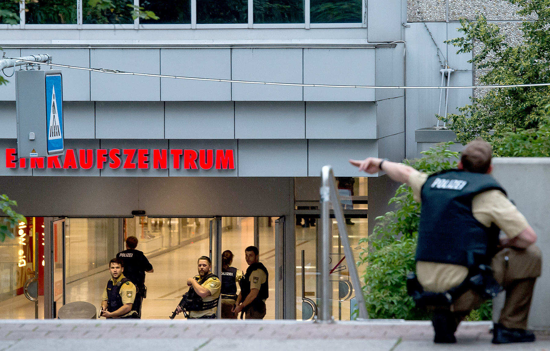 Police officers respond to a shooting at the Olympia Einkaufzentrum (OEZ) at July 22, 2016 in Munich, Germany.