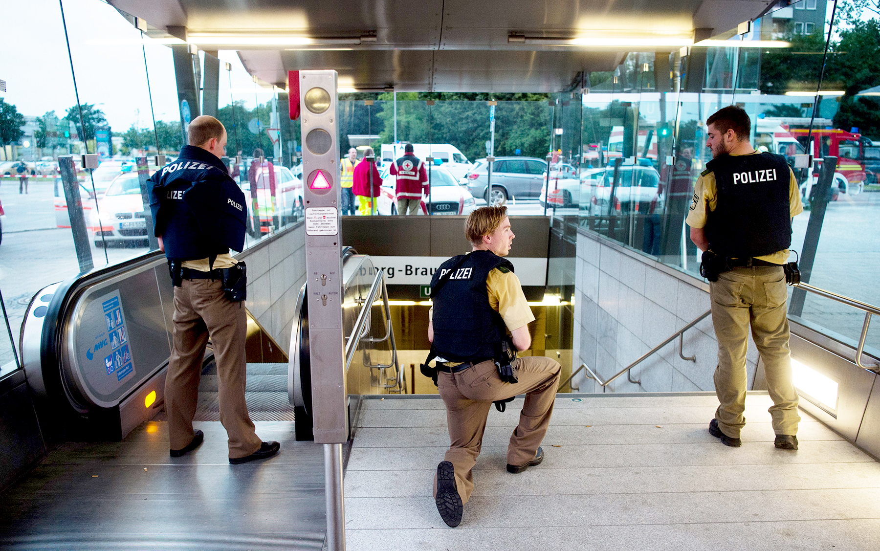 Police secures the entrance to a subway station near a shopping mall where a shooting took place on July 22, 2016 in Munich.