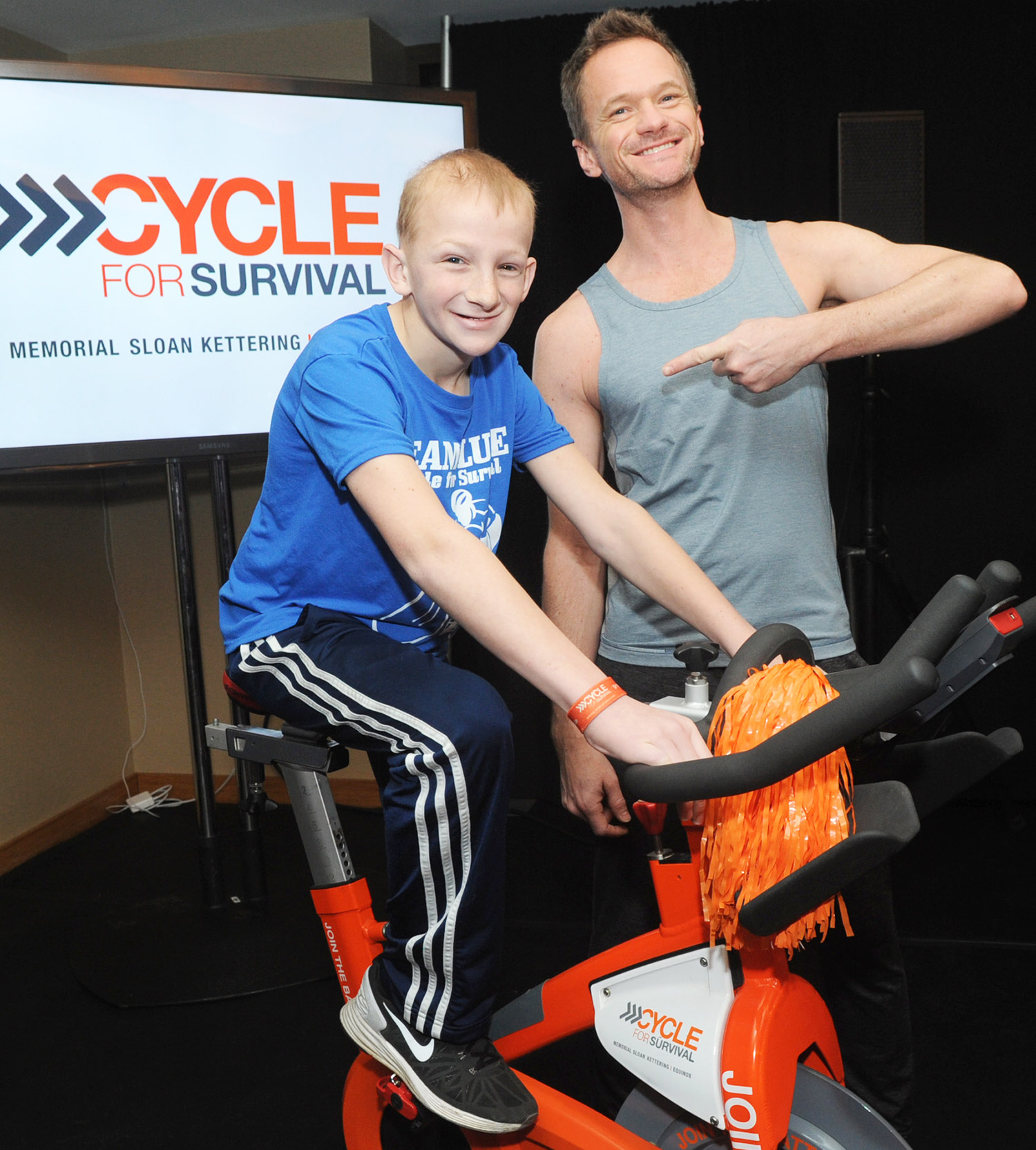 Neil Patrick Harris and 14-year-old cancer survivor Luke Weber at Cycle for Survival at Equinox Bryant Park March 13.