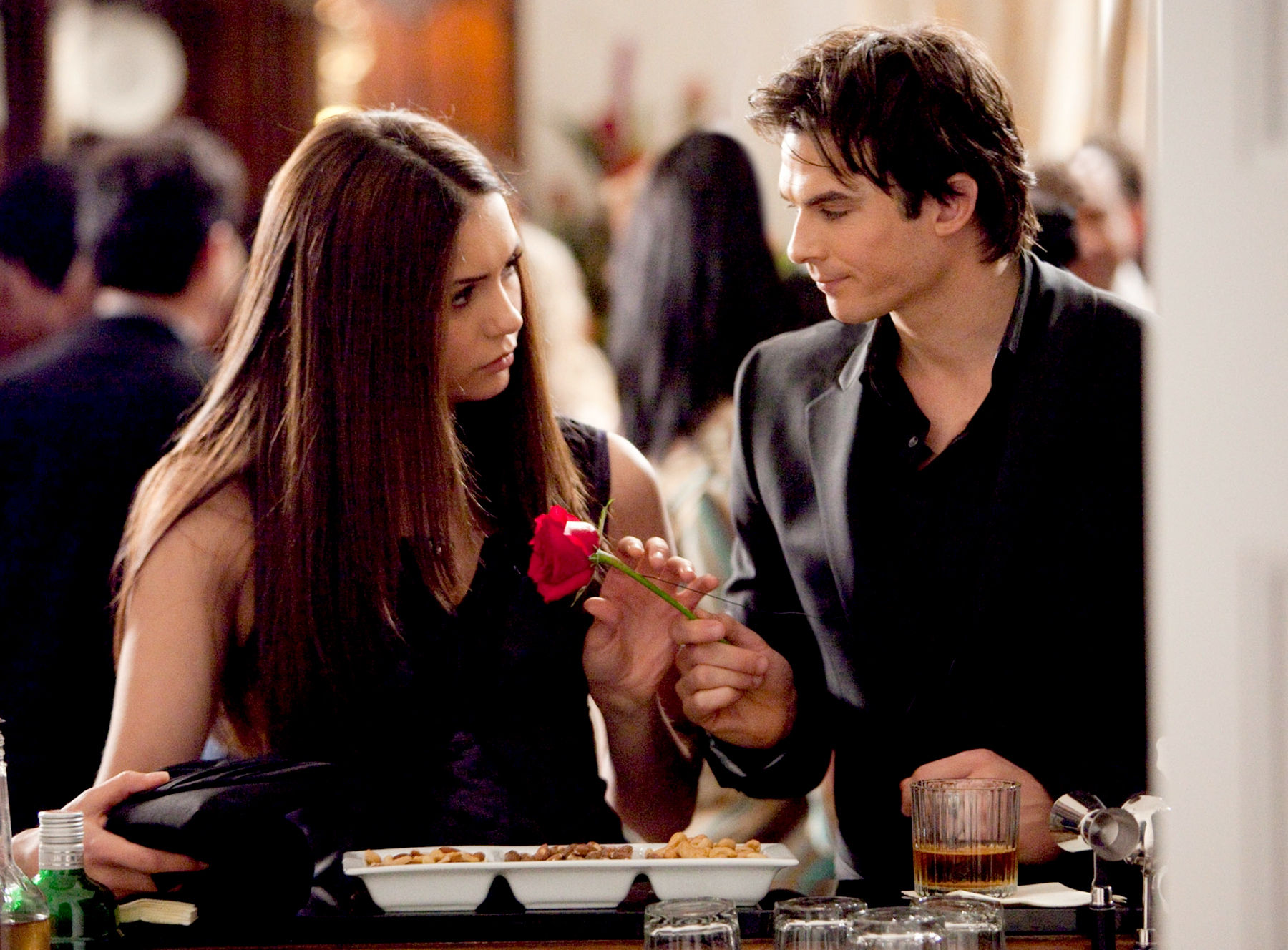 Nina Dobrev as Elena and Ian Somerhalder as Damon