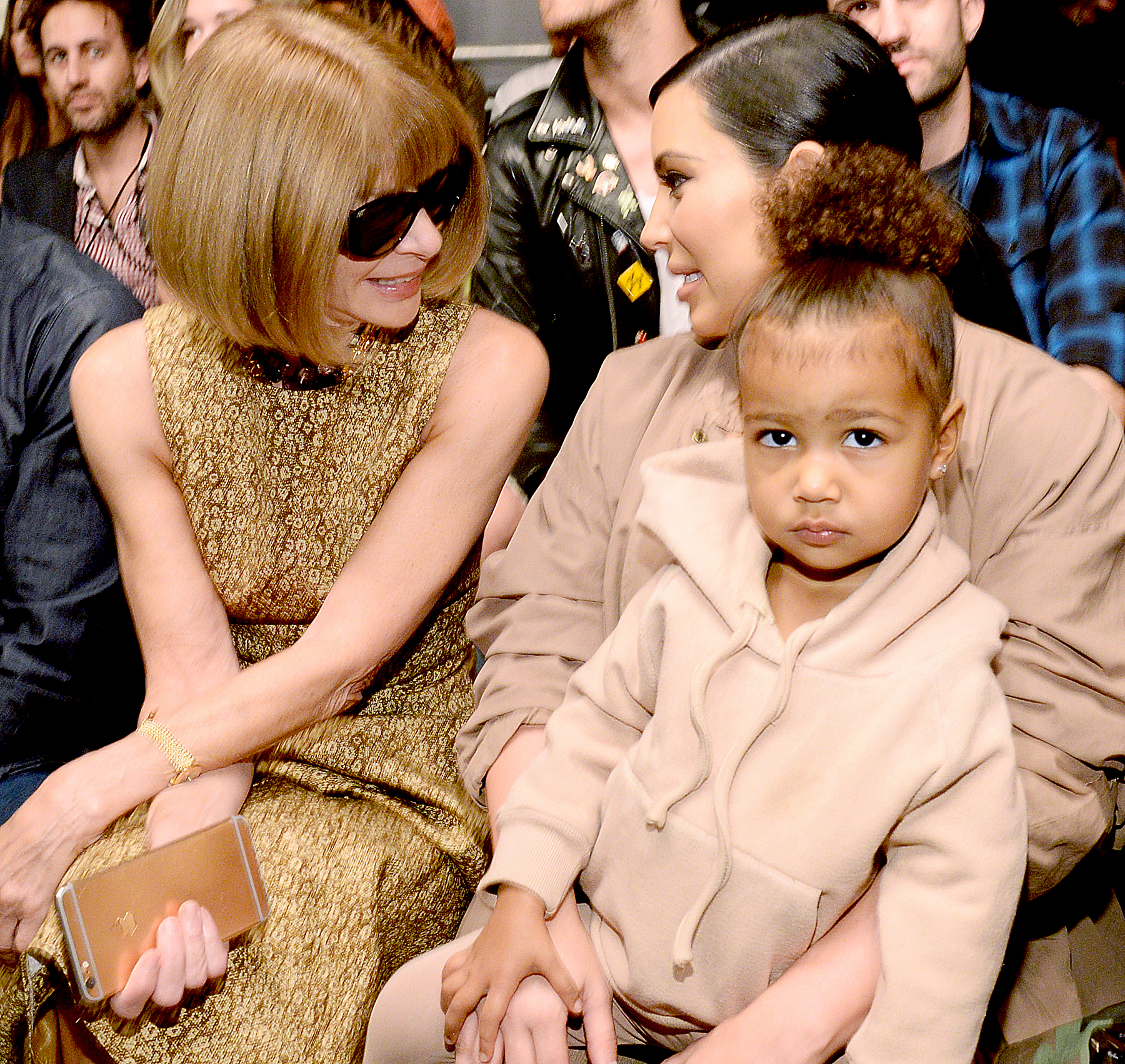 Anna Wintour, Kim Kardashian West and North West attend Kanye West Yeezy Season 2 during New York Fashion Week at Skylight Modern on September 16, 2015 in New York City.