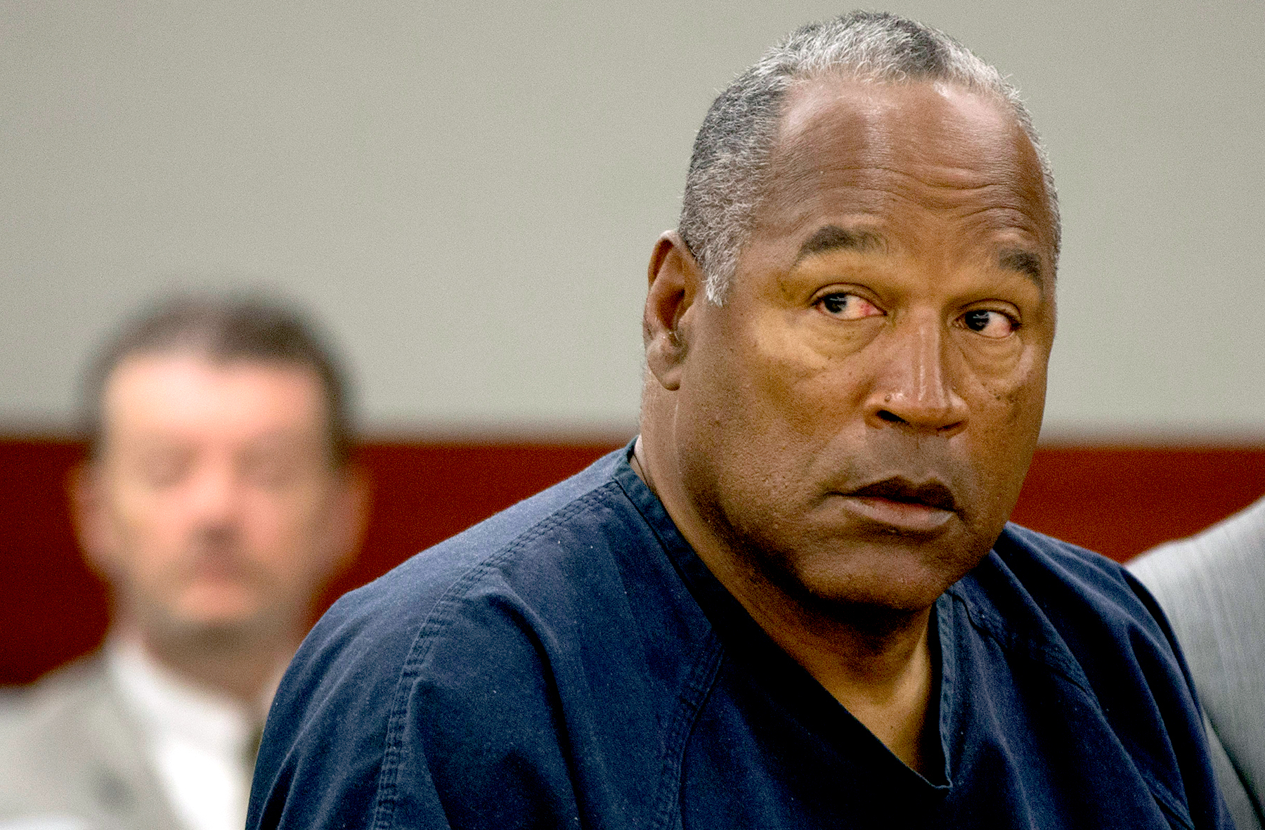 O.J. Simpson listens as his defense attorney, Ozzie Fumo, questions witness David Cook during an evidentiary hearing in Clark County District Court May 16, 2013 in Las Vegas, Nevada.