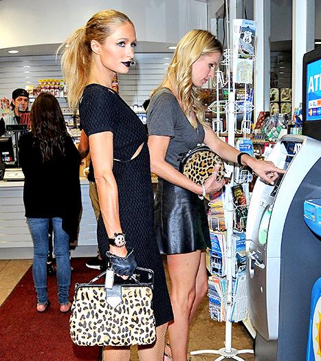 Paris Hilton and Nicky Hilton - Gas Station