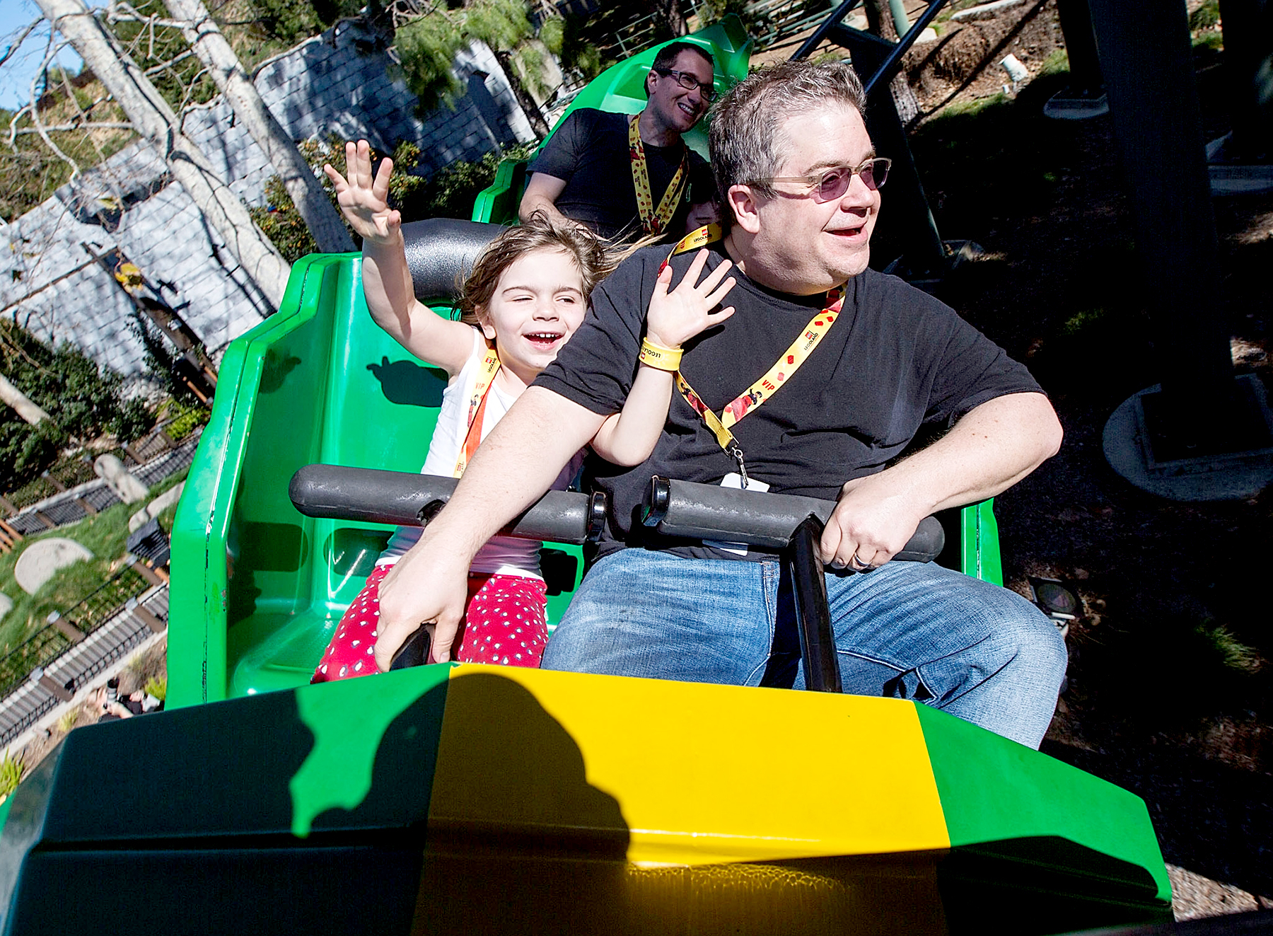Patton Oswalt and his daughter Alice Oswalt ride The Dragon roller coaster at LEGOLAND on February 6, 2016 in Carlsbad, California.