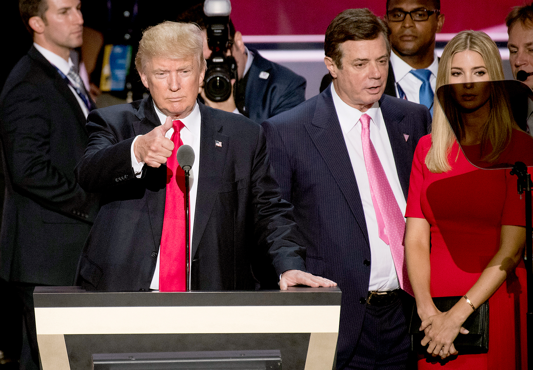 Donald Trump, flanked by campaign manager Paul Manafort and daughter Ivanka, checks the podium early Thursday afternoon in preparation for accepting the GOP nomination to be President at the 2016 Republican National Convention in Cleveland, Ohio on Wednesday July 20, 2016.