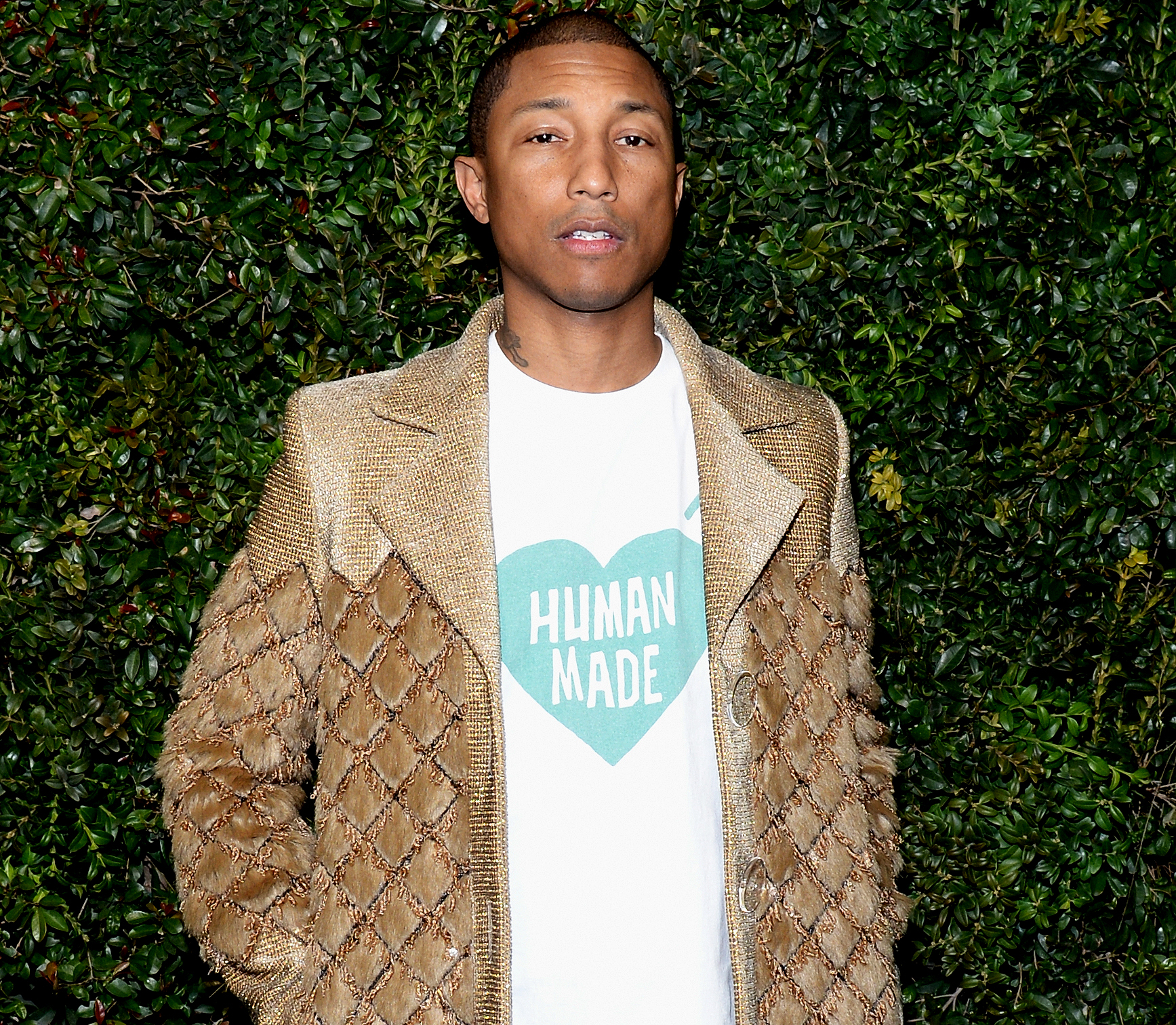 CHANEL Ambassador Pharrell Williams, wearing CHANEL, attends the Charles Finch and CHANEL Pre-Oscar Awards Dinner at Madeo Restaurant on February 25, 2017 in Beverly Hills, California.