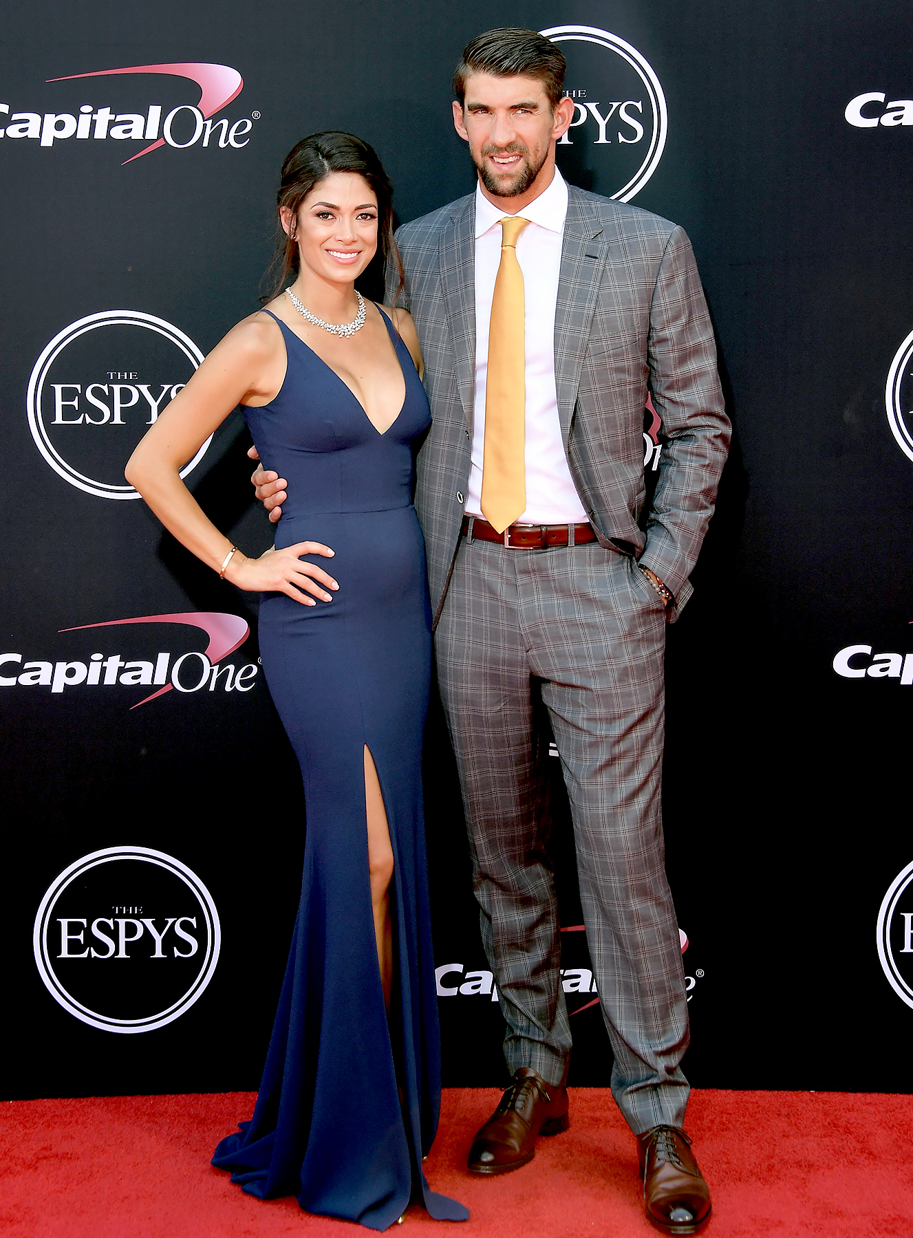 Michael Phelps (R) and Nicole Johnson attend The 2017 ESPYS at Microsoft Theater on July 12, 2017 in Los Angeles, California.
