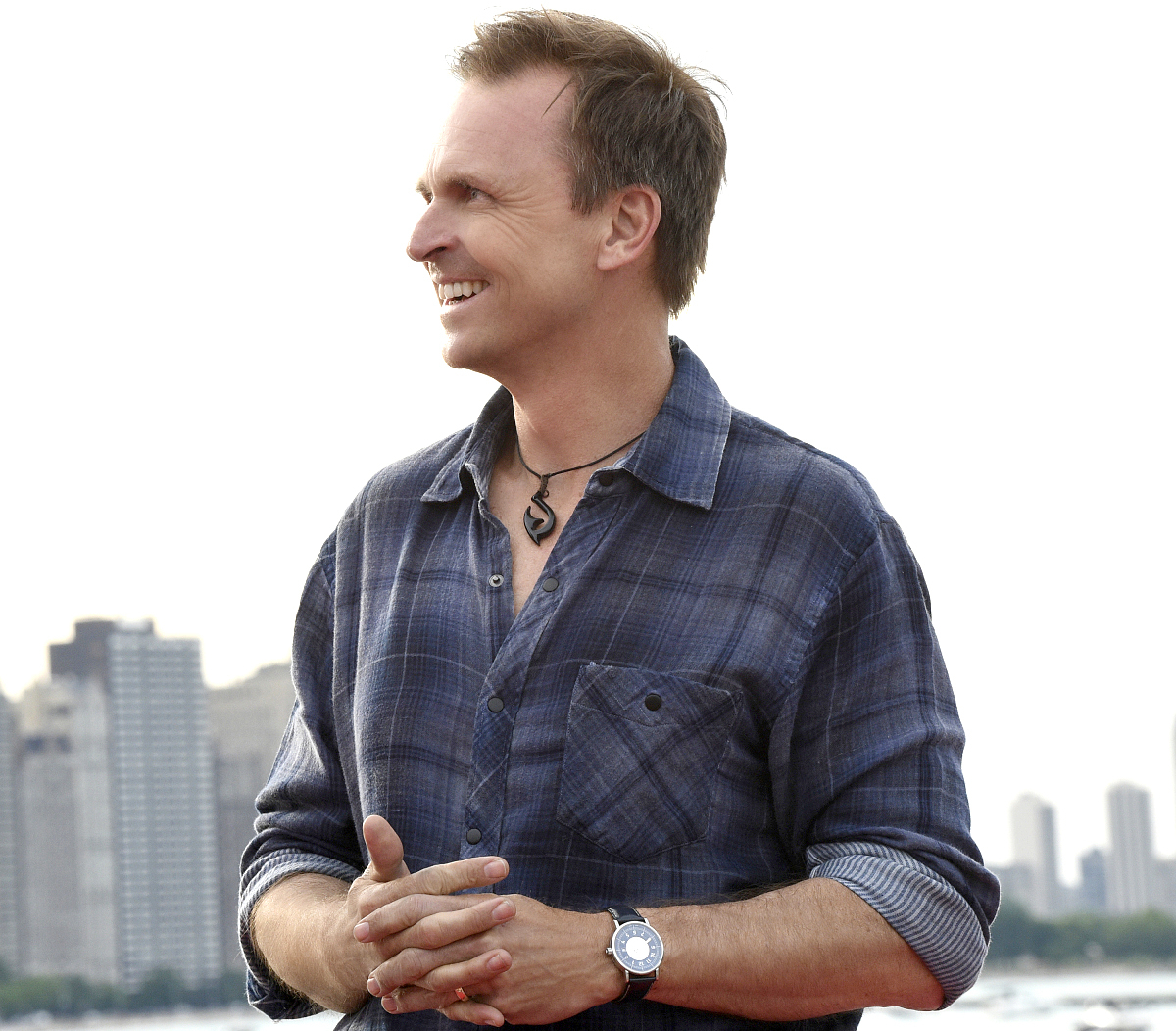 Host Phil Keoghan waits as team race to the finish line in Milton Lee III Olive Park in Chicago, Illinois on the 29th season finale of THE AMAZING RACE, Thursday, June 1.