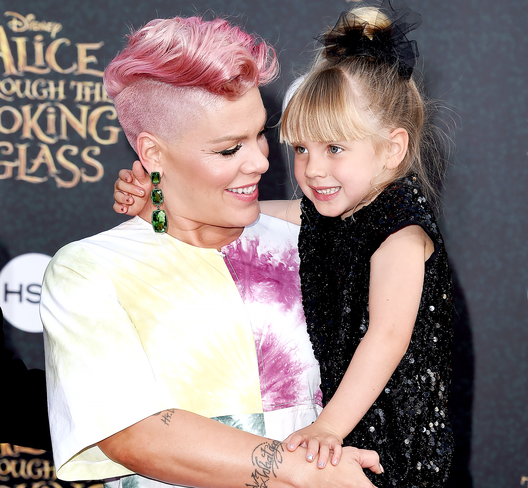 Pink and daughter Willow Sage Hart arrive at the premiere of Disney's 'Alice Through The Looking Glass' at the El Capitan Theatre on May 23, 2016 in Hollywood, California.