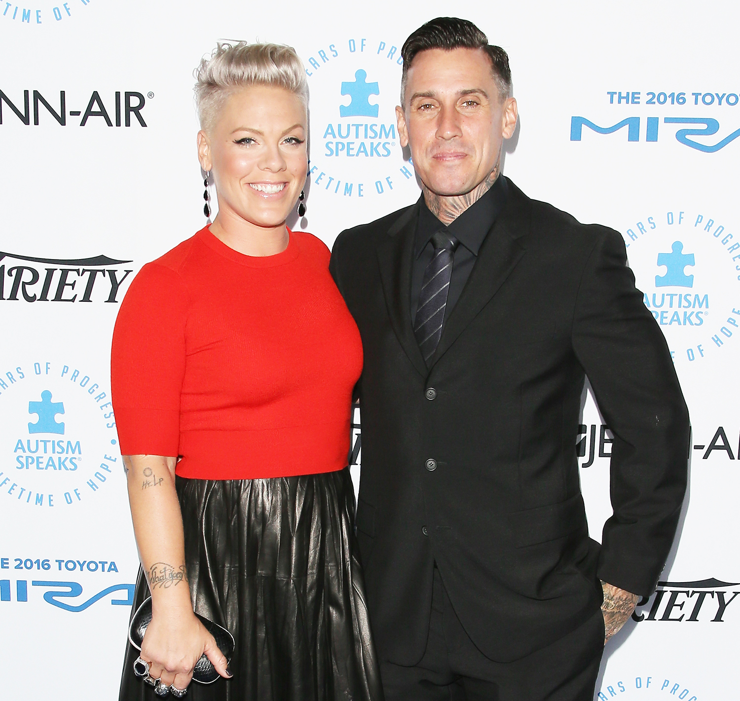 Pink and Carey Hart attend the Autism Speaks to Los Angeles celebrity chef gala held at the Barker Hangar on October 8, 2015 in Santa Monica, California.