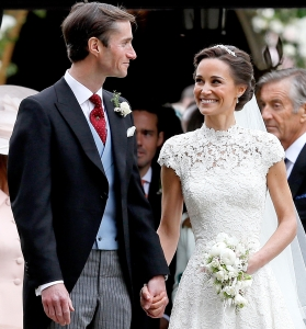 Pippa Middleton and James Matthews smile after their wedding at St Mark's Church on May 20, 2017 in in Englefield, England.