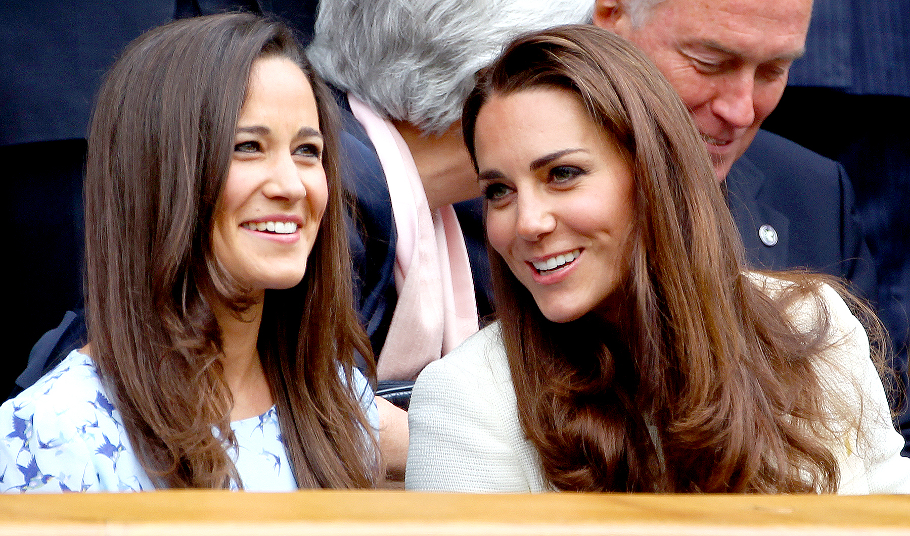 Pippa Middleton and Duchess Kate attend the Gentlemen's Singles final match at the Wimbledon Lawn Tennis Championships at the All England Lawn Tennis and Croquet Club in London on July 8, 2012.