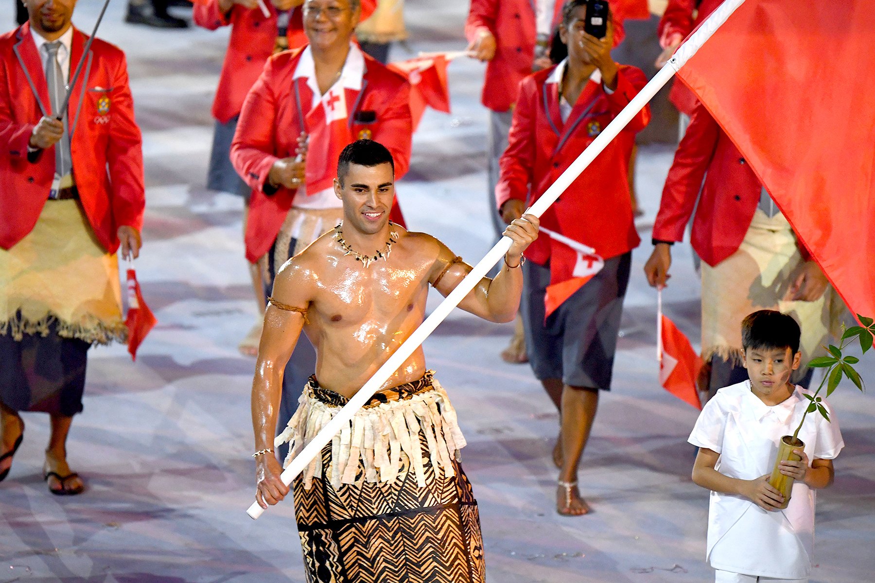 Tonga's flagbearer Pita Nikolas Taufatofua leads his delegation during the opening ceremony of the Rio 2016 Olympic Games at the Maracana stadium in Rio de Janeiro on August 5, 2016.