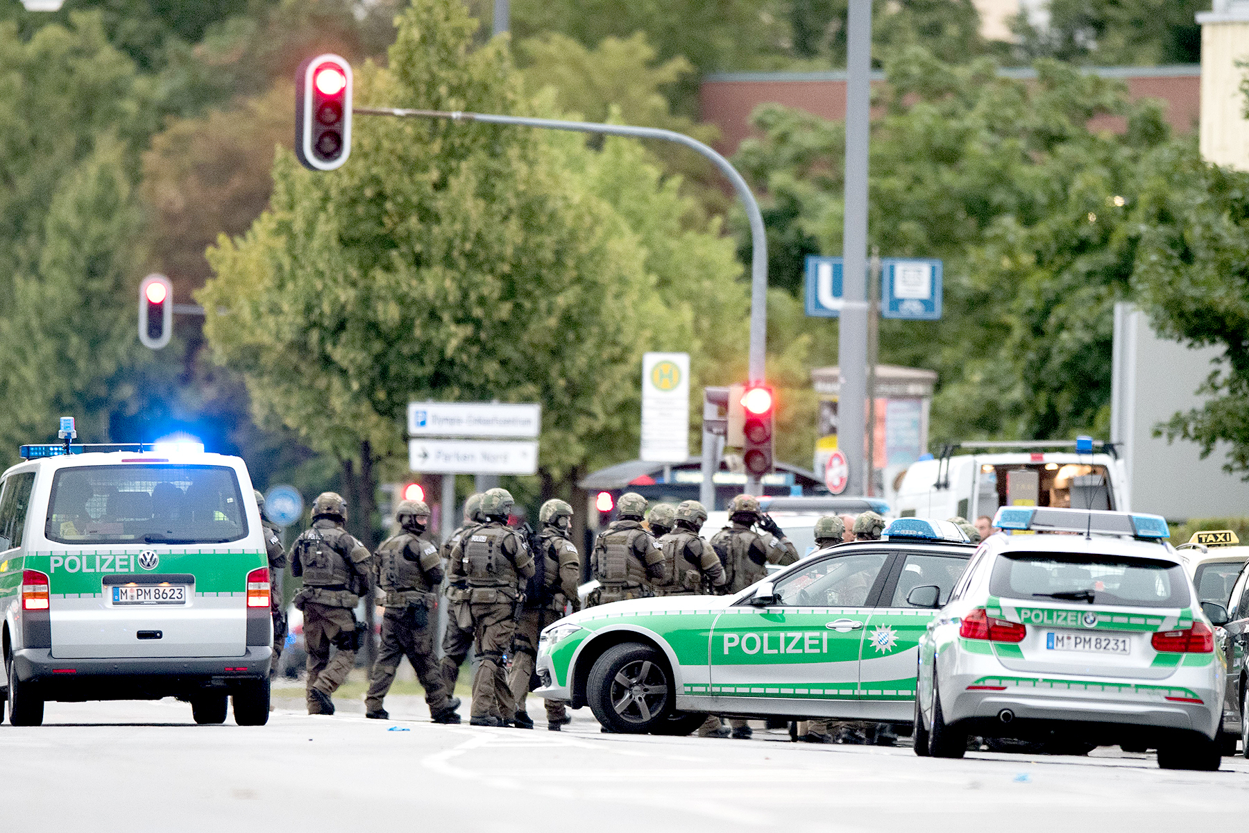 Special forces enter the shopping mall where shots were fired in Munich, Germany on July 22, 2016.